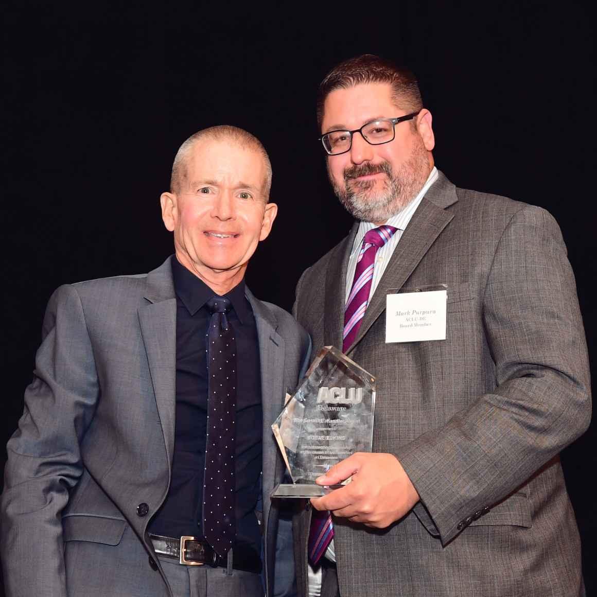 Mark Purpura and Murray Archibald accept award on behalf of Steve Elkins