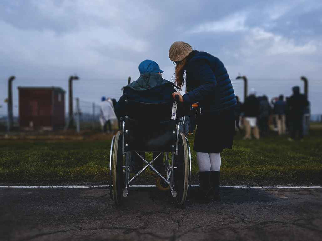 Person in wheelchair with caregiver
